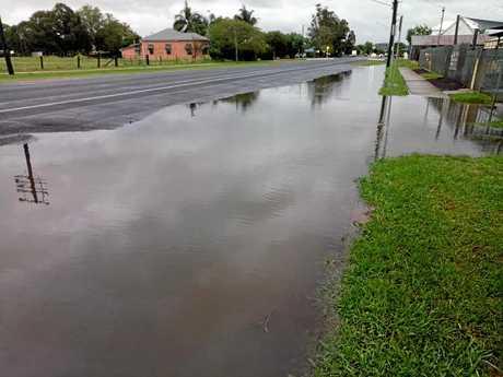Photos taken by Karen Strange on Saturday showing rainwater failing to drain away on Forde St.