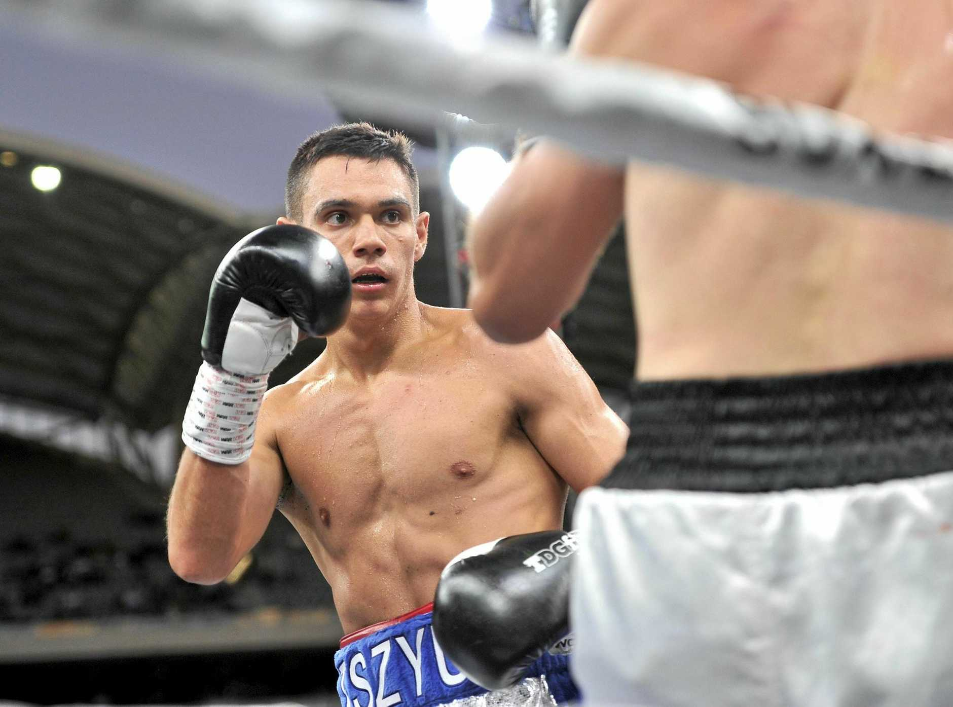 Australian boxer Tim Tszyu (left) faces off with Mark Dalby.