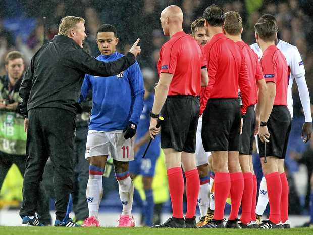 Everton's manager Ronald Koeman complains to referee Bas Nijhuis after a brawling Europa League between his side and Lyon.