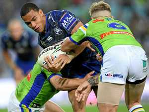 COMBATANTS: Will Hopoate of the Bulldogs is tackled by Elliot Whitehead, and Blake Austin of the Raiders last season. The two sides are set for a trial at Kawana.
