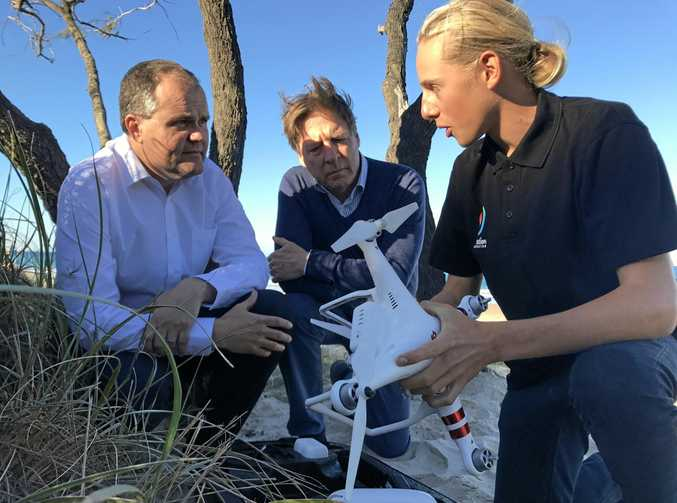 Generation Innovation challenge winner Eamon Kriz explains the workings of his photography drone to Ted O'Brien (left) and Tony Wellington (centre).