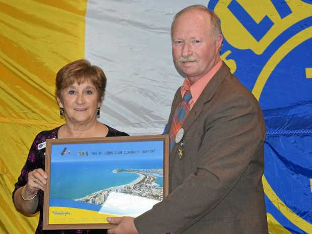 Mooloolaba Lions Club president Tim Fraser presents Mooloolaba Lioness Club president Maria Horan with the special thank-you.