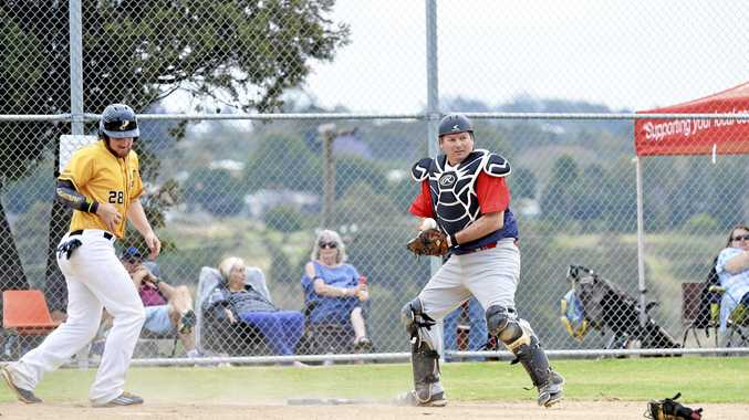 Toowoomba Rangers' coach and catcher Tony Tarca in action against Pine Hills in their season-opening round two weekends ago at Commonwealth Oval.