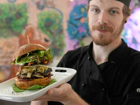 OODIES CAF: Chef Ben Vittle with the Works Burger. Tomato, beetroot, house made patty caramelised onion, cheese, egg, streaky bacon, lettuce, locally baked brioche roll.