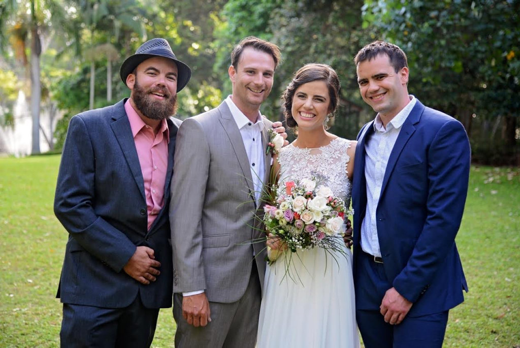 Brothers Josh (L) and Jack Formosa (R) celebrate the wedding of sister Amy and brother-in-law Ben Notley in Hervey Bay on October 9, 2016.