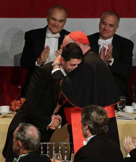 Speaker of the House Paul Ryan, R-Wis., left, hugs Cardinal Timothy Dolan after speaking during the 72nd Annual Alfred E. Smith Memorial Foundation dinner Thursday, Oct. 19, 2017, in New York.