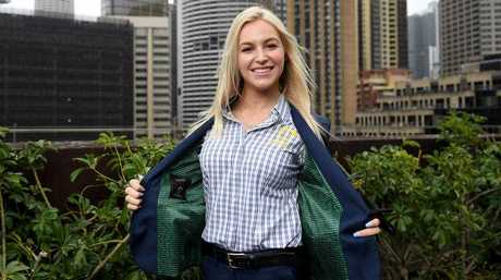 Australian aerial skier Danielle Scott poses for a photograph at the launch of the Australian team formal uniform for athletes competing in the 2018 PyeongChang Winter Olympic Games, in Sydney, Friday, October 20, 2017.