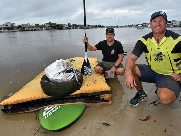 Ocean Crusaders founder Ian Thomson (right) and Michael Fox with some of the rubbish they hailed out of the Mooloolah River.