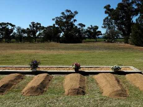 The stark reality of an entire family killed is evident at the burial plot of Kim Hunt, her three children and Geoff Hunt who shot them and himself dead.