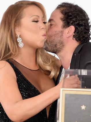 Singer Mariah Carey (L), with director/producer Brett Ratner, as she is honoured with Star on The Hollywood Walk of Fame on August 5, 2015. Picture: Getty