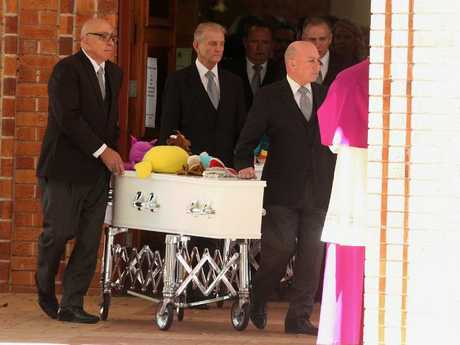 Coupled father killer: A coffin is wheeled at the funeral of the four members of the Colombian family gassed to death by the father, Manrique Fernando at Davidson in 2016. Picture: Adam Taylor