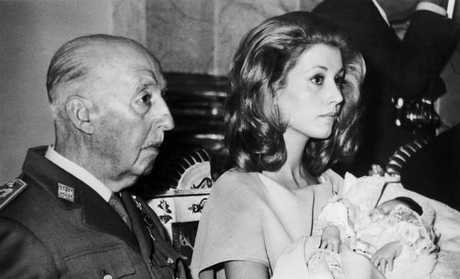 Late Spanish dictator Francisco Franco Attending with his granddaughter Maria Carmen Martinez Bordiu Y Franco,at he christening of his great grandson Francesco in Madrid in 1972. Picture: Getty