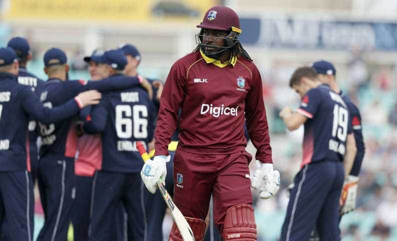 West Indies' Chris Gayle leaves the pitch after being caught by England's Joe Root off the bowling of England's Chris Woakes during the One Day International cricket match between England and the West Indies at the Oval cricket ground in London, Wednesday, Sept. 27, 2017.