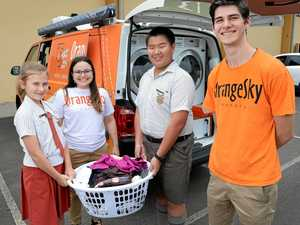 School kids take helping with the laundry to heart