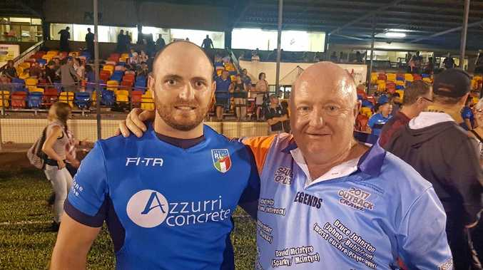 WELL PLAYED: Gavin Hiscox catches up with dad Dave after playing for Italy in the trial game against Tonga in Innisfail.