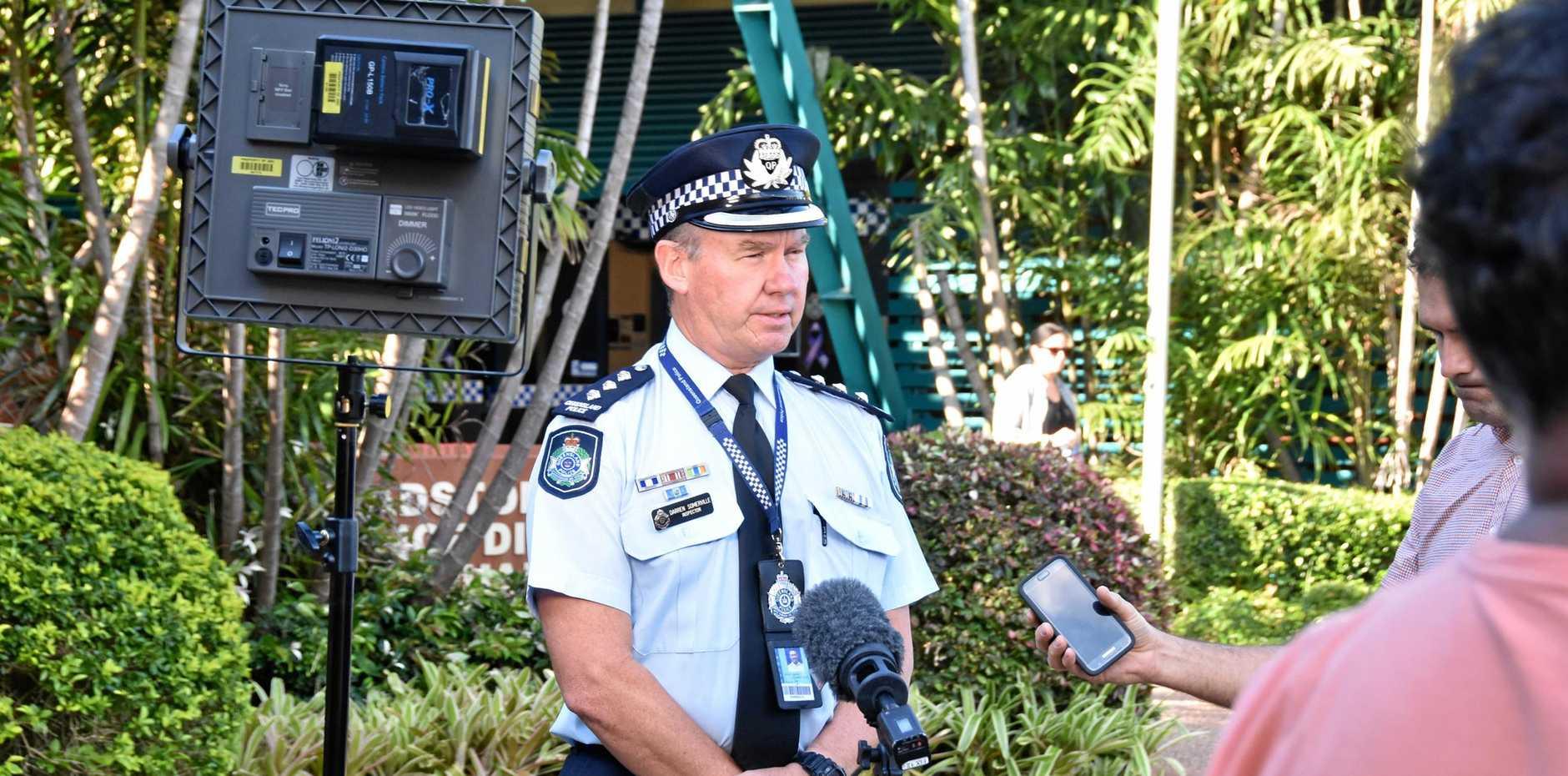 FOUR MISSING: Inspector Darren Somerville addresses the media outside Gladstone Police Station.