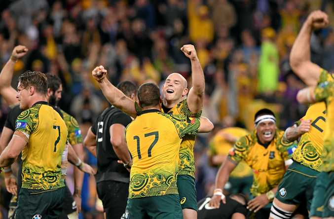Stephen Moore (centre), in his 125th and last game for the Wallabies, celebrates defeating the All Blacks with teammates.