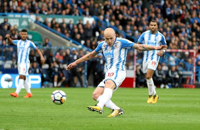 Aaron Mooy scores Huddersfield's first goal in the 2-1 win over Manchester United.