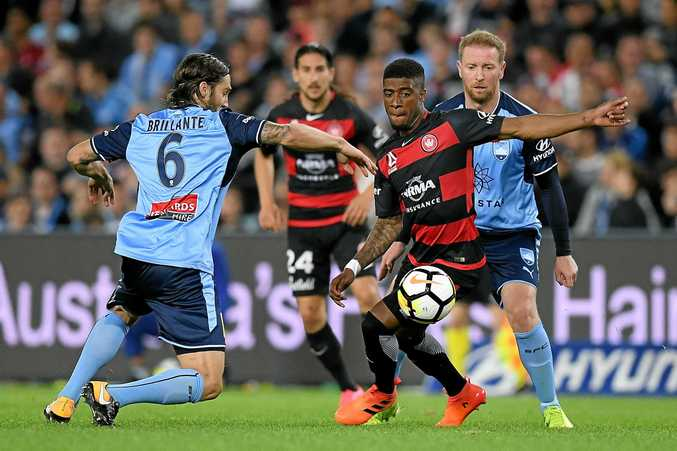 Roly Bonevacia of the Wanderers competes for possession with Joshua Brilliante of Sydney (left).