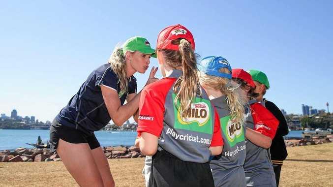 MILO junior cricket ambassador Holly Ferling coaching some MILO juniors.