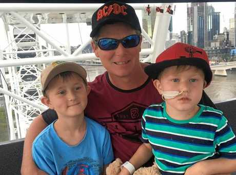 BRAVE BOY: Kye (right) pictured with his father Scott and brother Kody.