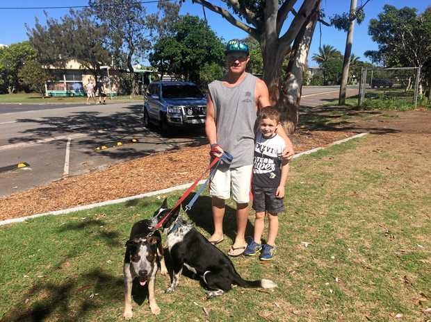 MAKING THE MOST OF IT: Dave Maurer and son Jordan Maurer escape the house with Roxy and Spot at Rainbow Beach.