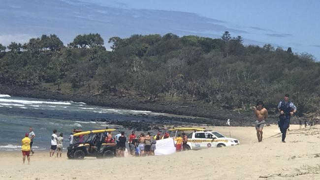 Police on a beach at Fingal Head after a 20-year-old swimmer went missing. Picture: Phoebe Moore, Channel 9