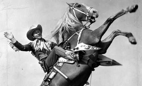 Actor Roy Rogers riding horse Trigger.