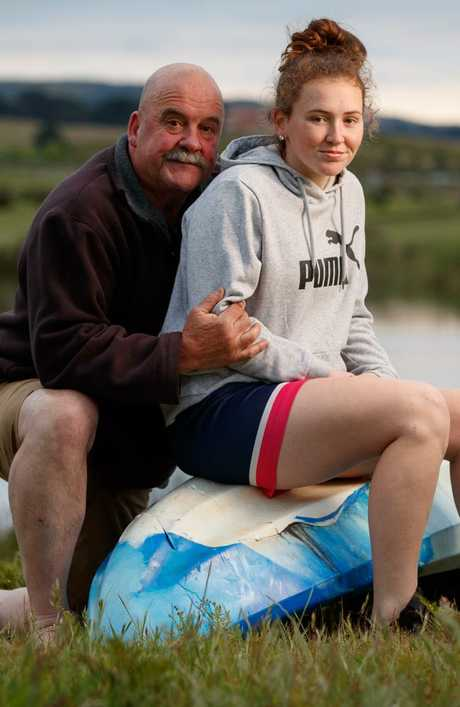 Chris Williams with his daughter Sarah, 15, who was knocked off her kayak by a great white shark. Picture: Matt Turner