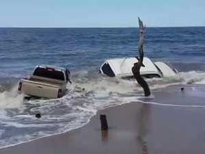 Four-wheel drives stuck on beach