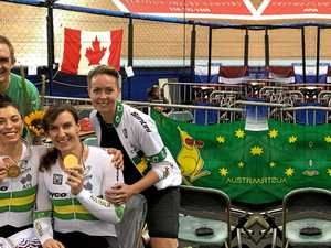 MASTERS MEDALS: Grafton track cyclist Laurelea Moss, her teammate Rebecca Wheadon and their support team celebrate gold in Las Angeles.