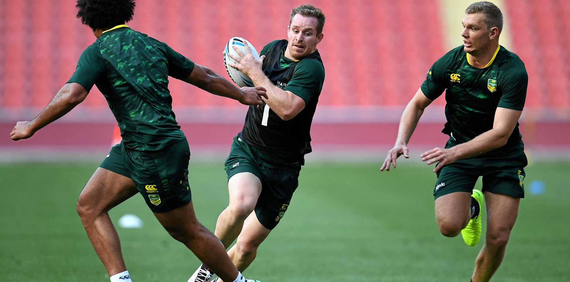 Michael Morgan (centre) during training in Brisbane