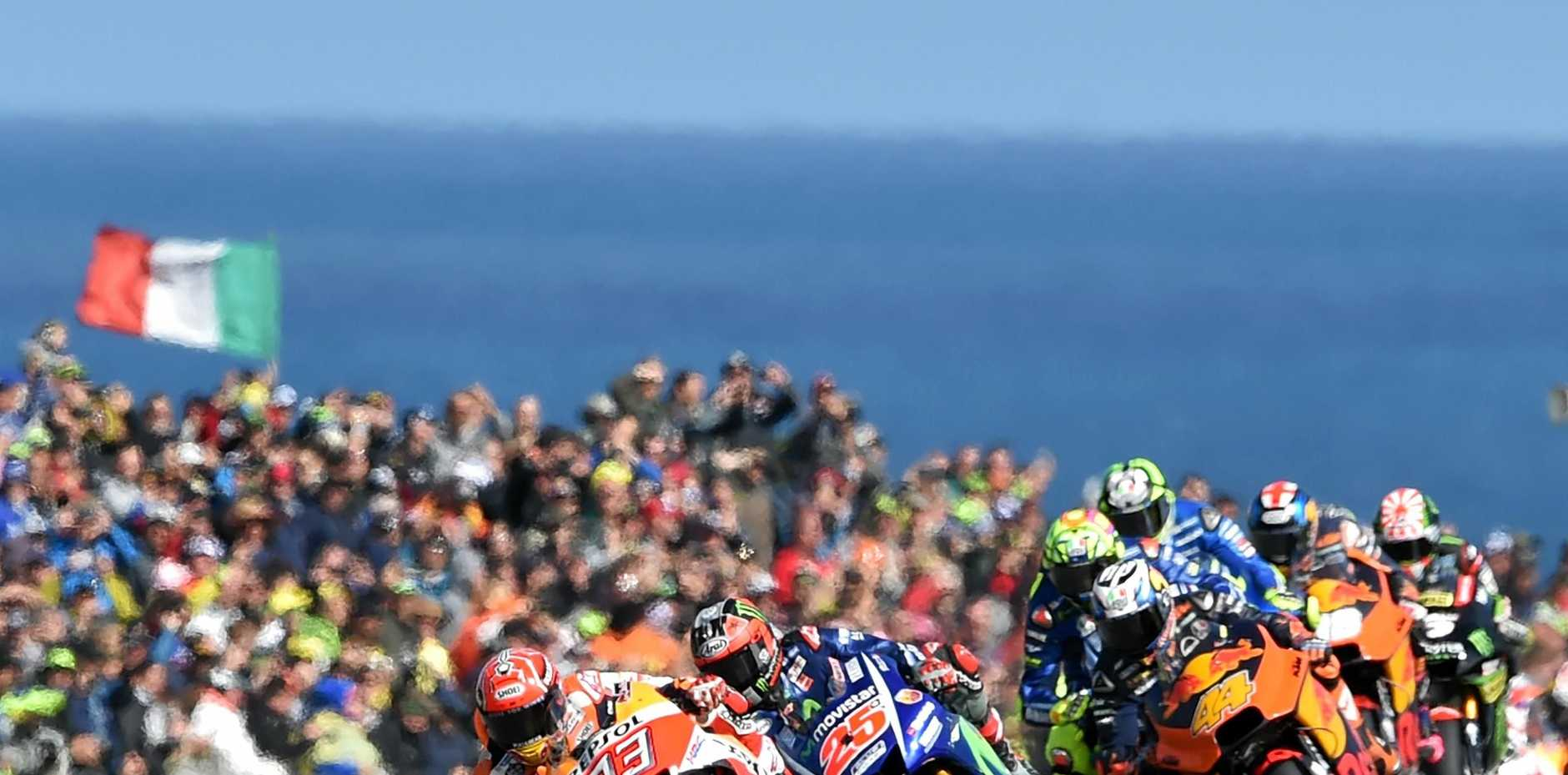 ON TRACK: Honda rider Marc Marquez of Spain (left) on his way to winning the Australian MotoGP.