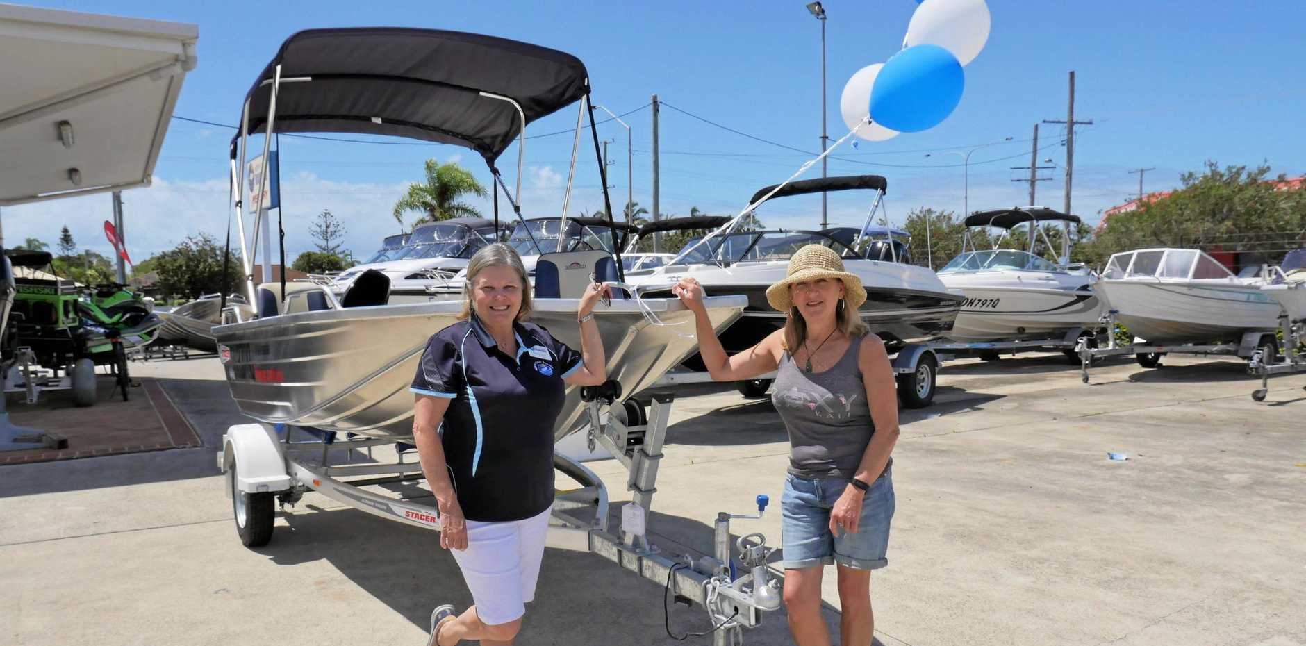 North Coast Boating's Nereis Long with the boat winner Alicia Davies from Coolum Beach.