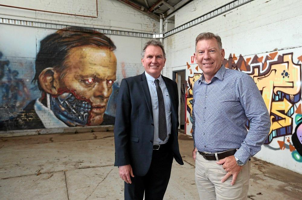 CHANGES: Councillors David Morrison (left) and Deputy Mayor Wayne Wendt hope for approval for demolition work at the North Ipswich Woollen Mills.