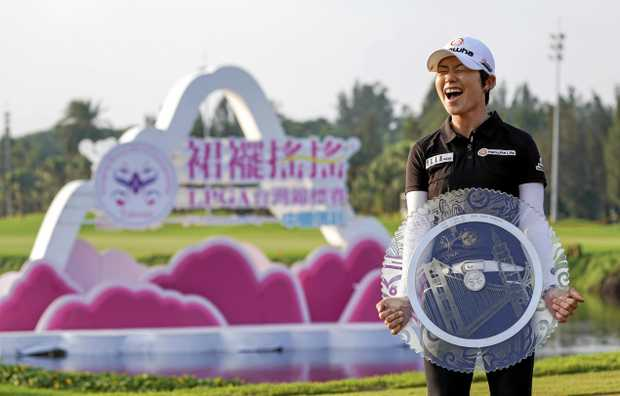 CHAMP: Eun-Hee Ji celebrates after winning the Swinging Skirts LPGA golf championship. She often visited Bargara during the Korean winter to be coached by local Phil Curd.
