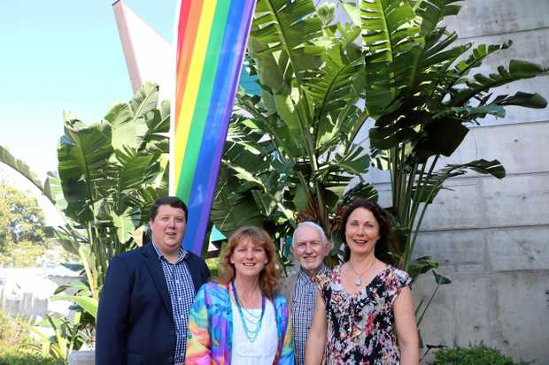 RAINBOW FLAG: Showing support for a Yes vote are (from left): Deputy Mayor Reece Byrnes, Mayor Katie Milne, Cr Ron Cooper and Cr Chris Cherry.