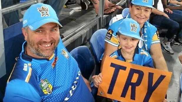 Mark and Karen Genders with their son Jack at a Gold Coast Titans game.