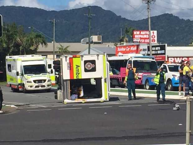 An ambulance has landed on its side after a crash outside the Cape York Hotel in Cairns.