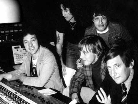 Bon Scott, Angus Young, George Young, Harry Vanda and Ted Albert in the studio.