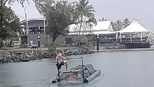 Group of men playing around with a floating crocodile trap off Port Douglas. Source: Facebook