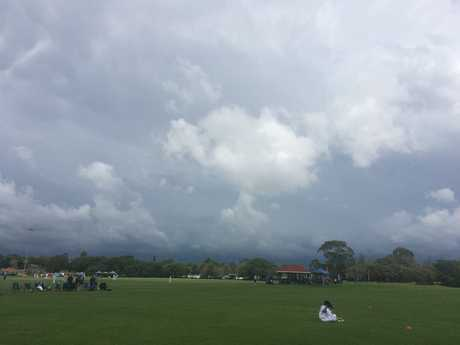 Dark skies above Captain Cook Oval.