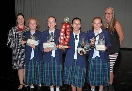 WELL-READ: Sunshine Coast Libraries youth librarian Karen Gawen congratulates the Matthew Flinders winners Sarah Ridgewell (teacher librarian), Juliette Wortman, Emily Myers, Priya Ridgley and Laura Webb.