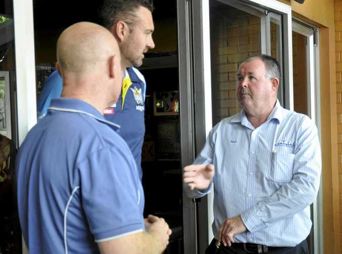 Western Mustangs chairman Paul Reedy (right) talks with Gold Coast Titans general manager for memberships and community about how they can make the most of the historic NRL match in the region.