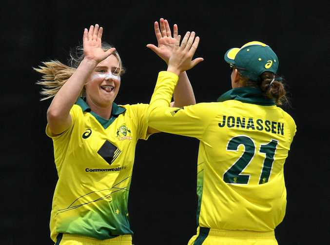 Australia's Ellyse Perry (left) celebrates after taking a wicket in the first women's Ashes Test.