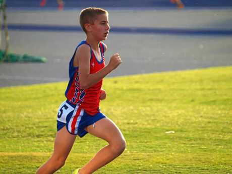 Charlie Randall wins gold in the 11 years 800m and 1500m at the Queensland Athletics Championships earlier this month.