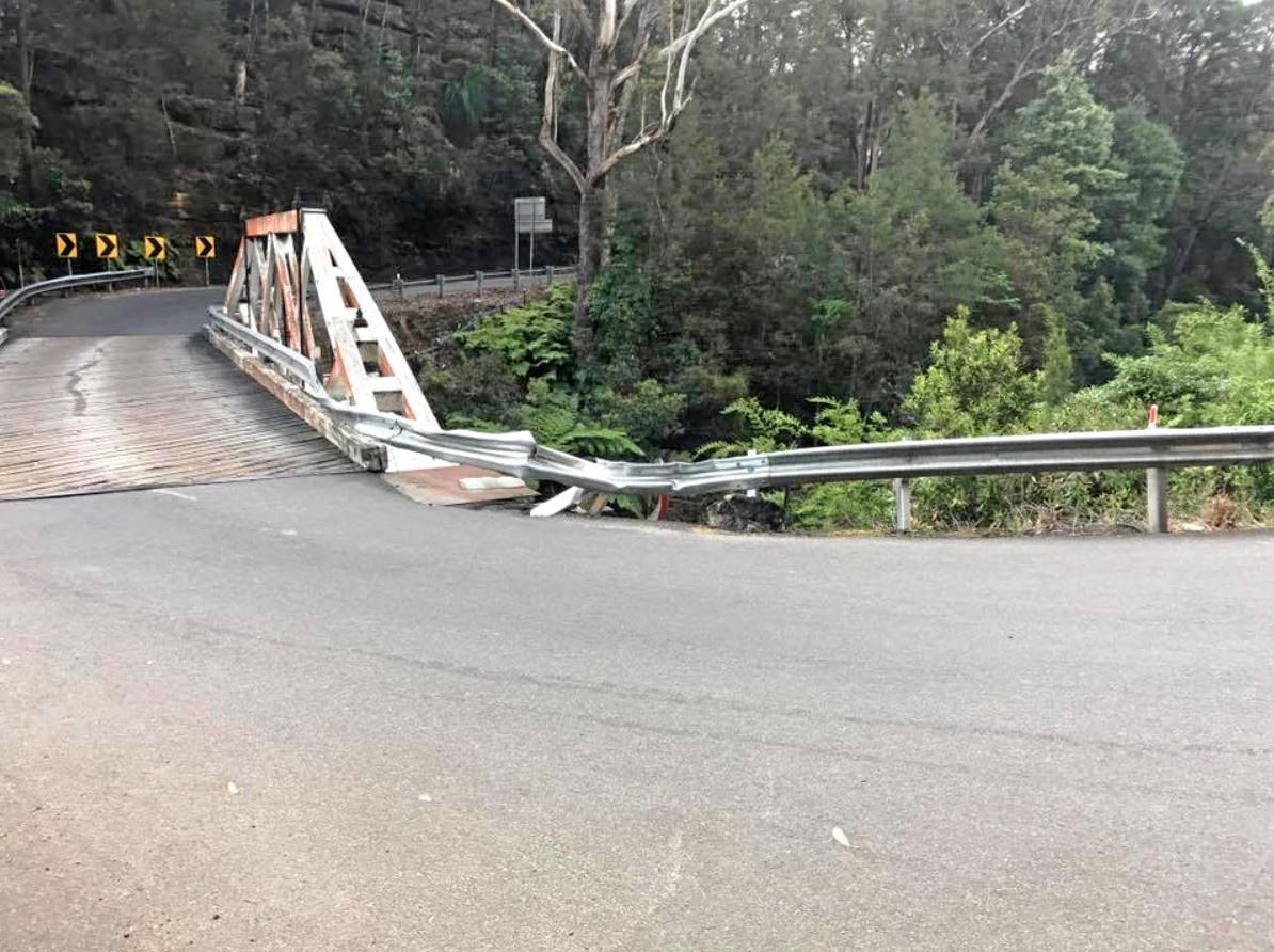 A damaged guard rail along the bridge over Tunks Creek.