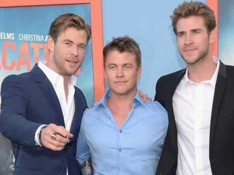 The Hemsworth brothers (from left) Chris, Luke and Liam Hemsworth used to fight tooth and nail as children — and occasionally with firearms too. Picture: Jason Kempin/Getty Images