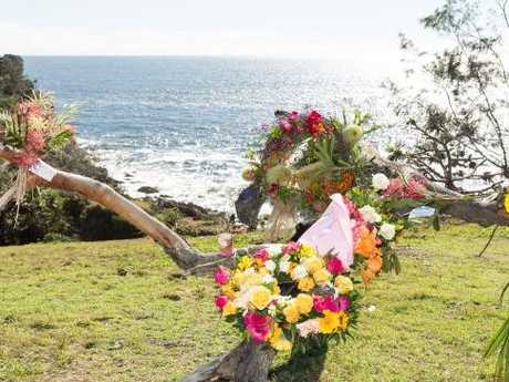 Floral tributes are seen at the Seventeen Seventy Headland, Gladstone. (AAP Image/Natalia Muszkat)