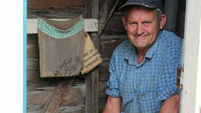 AUSSIE ICON: Graeme Neilson with one of Laidley's last outhouses.